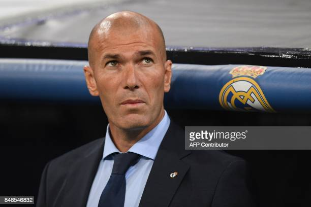Real Madrid's coach from France Zinedine Zidane looks on before the UEFA Champions League football match Real Madrid CF vs APOEL FC at the Santiago...