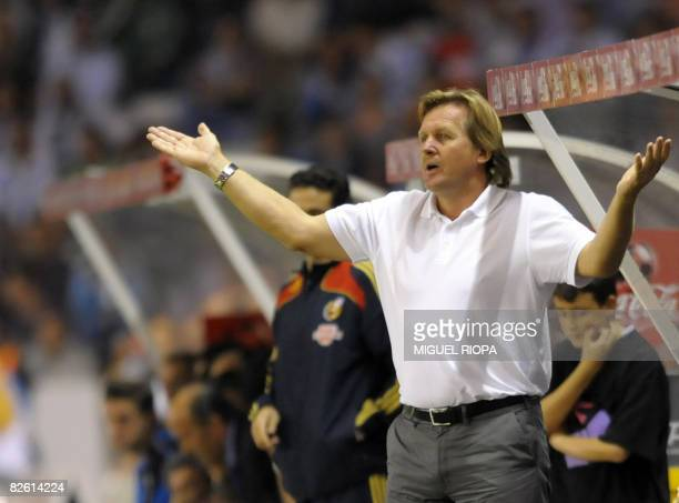 Real Madrid's coach German Bernd Schuster reacts during their Spanish first league football match against Deportivo Coruna at the Riazor Stadium in...