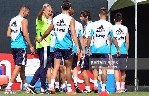 Real Madrid's coach Jose Mourinho greets Cristiano Ronaldo during a training sesison at UCLA on August 1 2012 in Los ANgeles California ahead of the...