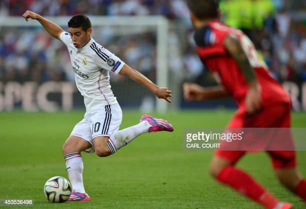 Real Madrids Colombian forward James Rodriguez passes with the ball during the UEFA Super Cup football match between Real Madrid and Sevilla at...
