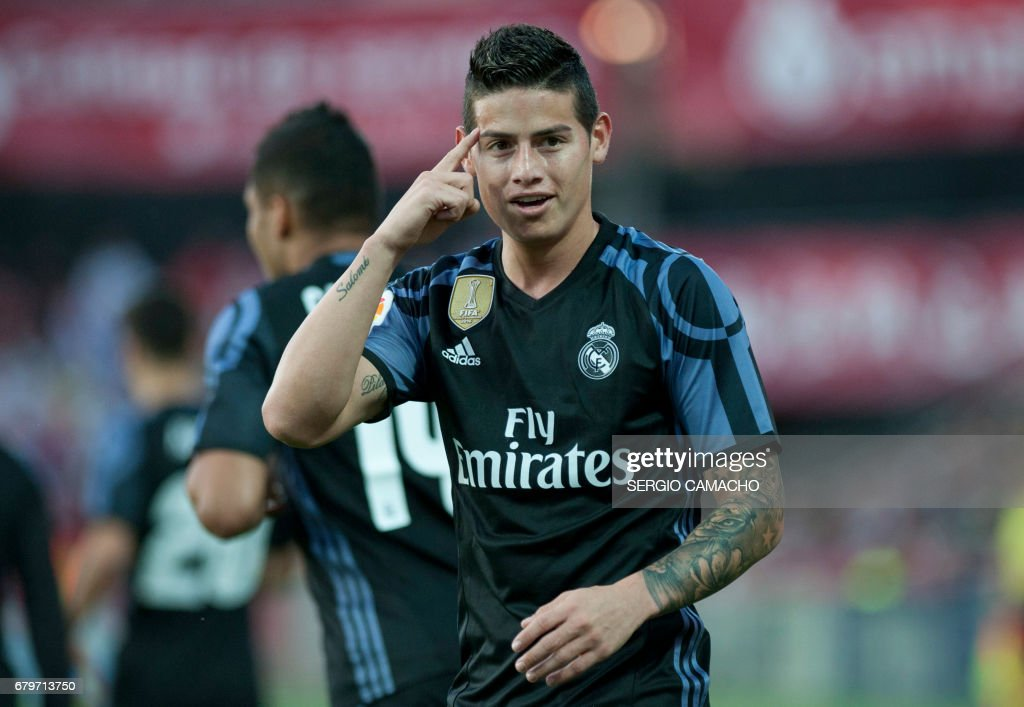 Real Madrid's Colombian midfielder James Rodriguez celebrates after scoring a goal during the Spanish league football match Granada FC vs Real Madrid CF at Nuevo Los Carmenes stadium in Granada on May 6, 2017. /