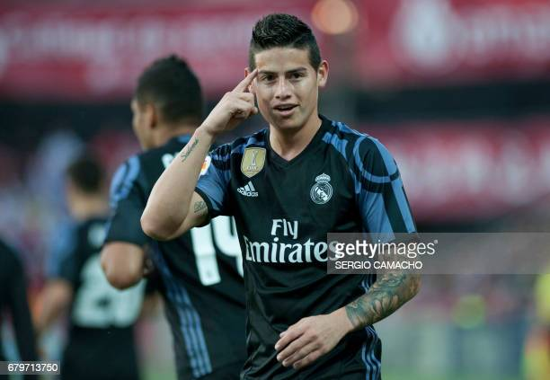 Real Madrid's Colombian midfielder James Rodriguez celebrates after scoring a goal during the Spanish league football match Granada FC vs Real Madrid...