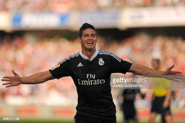 Real Madrid's Colombian midfielder James Rodriguez celebrates after scoring during the Spanish league football match Granada CF vs Real Madrid at the...