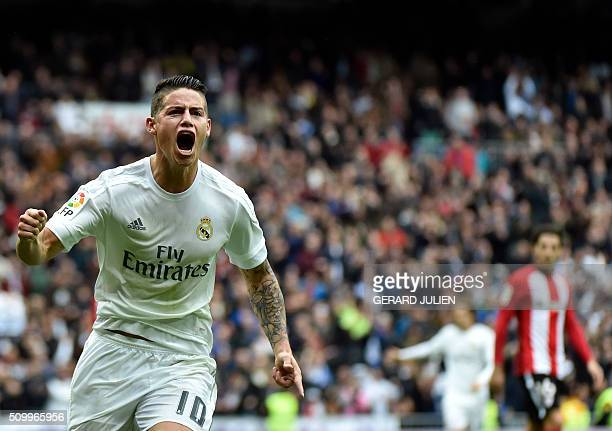 Real Madrid's Colombian midfielder James Rodriguez celebrates after scoring during the Spanish league football match Real Madrid CF vs Athletic Club...