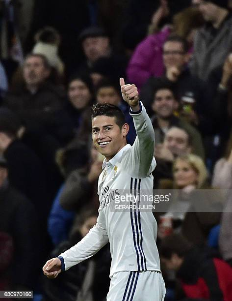 TOPSHOT Real Madrid's Colombian midfielder James Rodriguez celebrates after scoring during the Spanish Copa del Rey round of 16 first leg football...