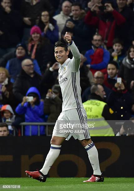 Real Madrid's Colombian midfielder James Rodriguez celebrates after scoring during the Spanish Copa del Rey round of 16 first leg football match Real...