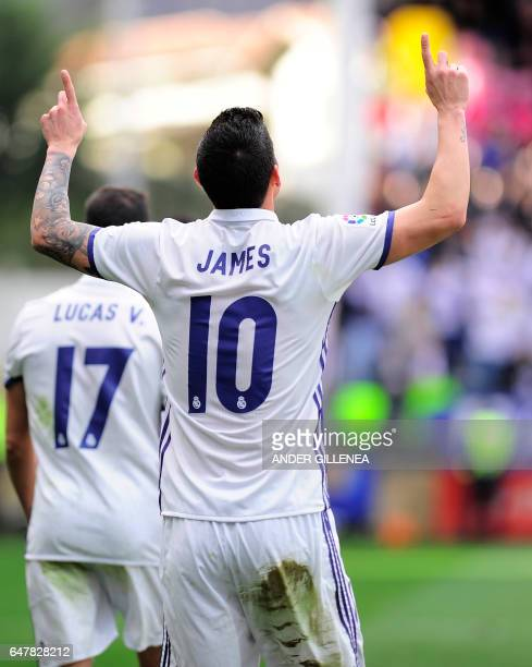 Real Madrid's Colombian midfielder James Rodriguez celebrates after scoring their team's third goal during the Spanish league football match SD Eibar...