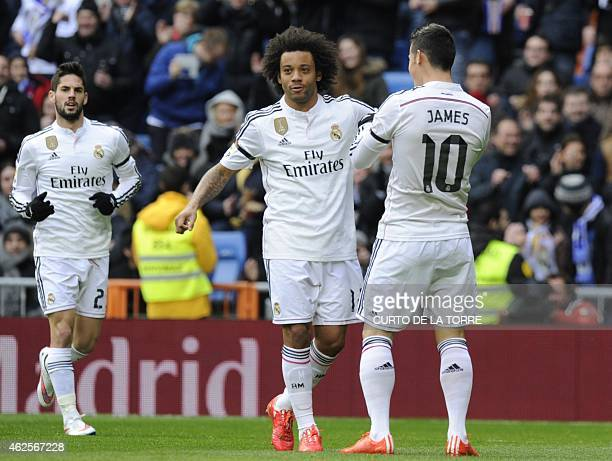 Real Madrid's Colombian midfielder James Rodriguez celebrates with Real Madrid's Brazilian defender Marcelo after scoring during the Spanish league...