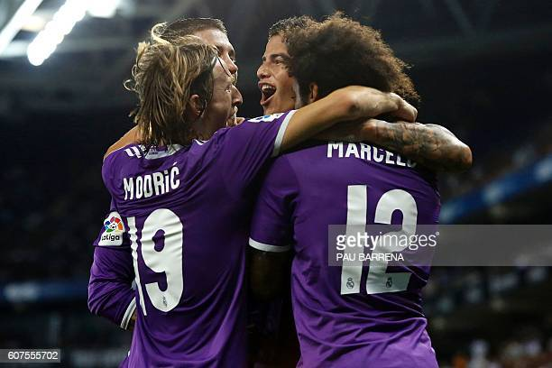 Real Madrid's Colombian midfielder James Rodriguez celebrates with teammates after scoring during the Spanish league football match RCD Espanyol vs...