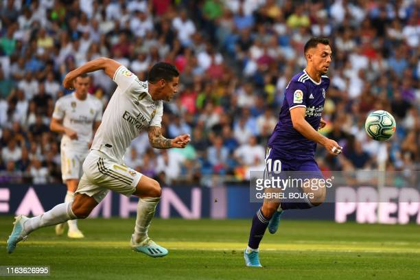 Real Madrid's Colombian midfielder James Rodriguez challenges Valladolid's Spanish midfielder Oscar Plano during the Spanish League football match...