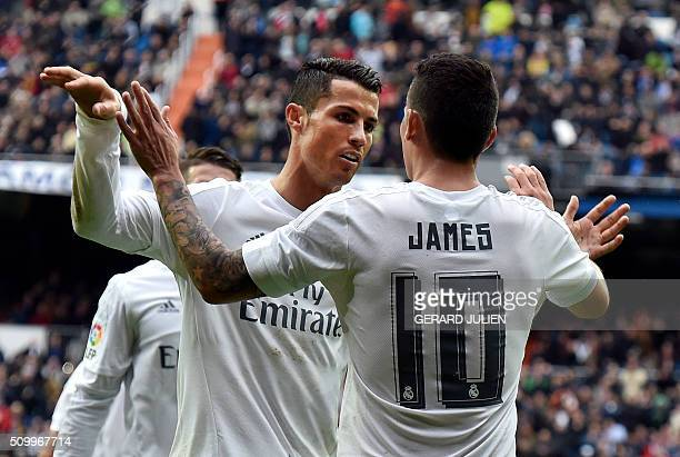 Real Madrid's Colombian midfielder James Rodriguez is congratulated by Real Madrid's Portuguese forward Cristiano Ronaldo during the Spanish league...