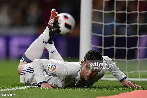 Real Madrid's Colombian midfielder James Rodriguez lies on the ground as he celebrates after scoring during the Spanish Copa del Rey Round of 32...