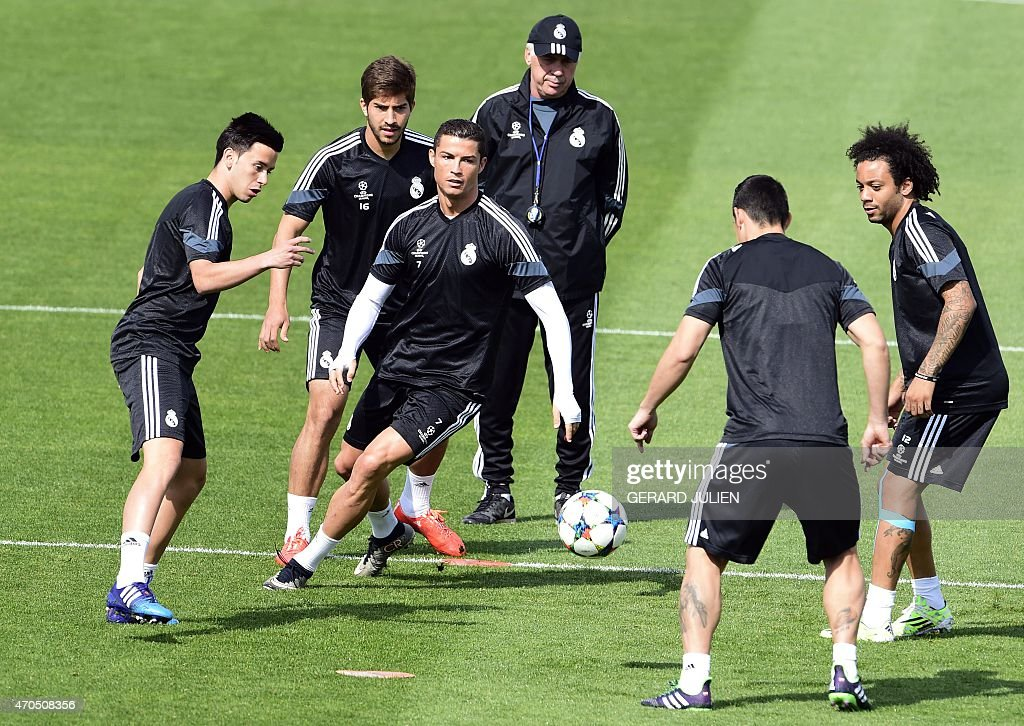 Real Madrid's Colombian midfielder James Rodriguez, Real Madrid's Brazilian midfielder Lucas Silva, Real Madrid's Portuguese forward Cristiano Ronaldo, Real Madrid's Italian coach Carlo Ancelotti and Real Madrid's Brazilian defender Marcelo (R) take part in a training session at Valdebebas training ground in Madrid on April 21, 2015, on the eve of the UEFA Champions League quarter-final secong leg football match Real Madrid CF vs Atletico Madrid.