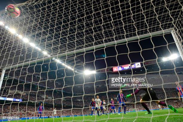 Real Madrid's Colombian midfielder James Rodriguez scores a goal during the Spanish league football match Real Madrid CF vs FC Barcelona at the...