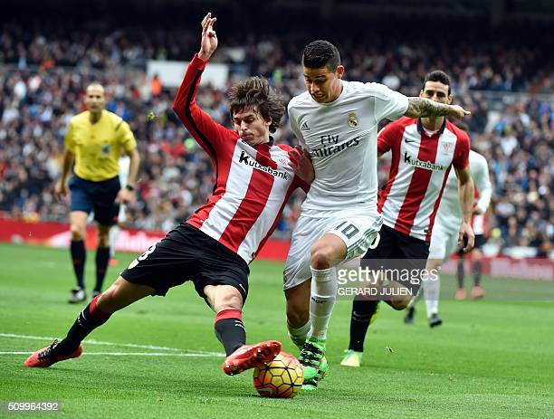 TOPSHOT Real Madrid's Colombian midfielder James Rodriguez vies with Athletic Bilbao's midfielder Ander Iturraspe during the Spanish league football...