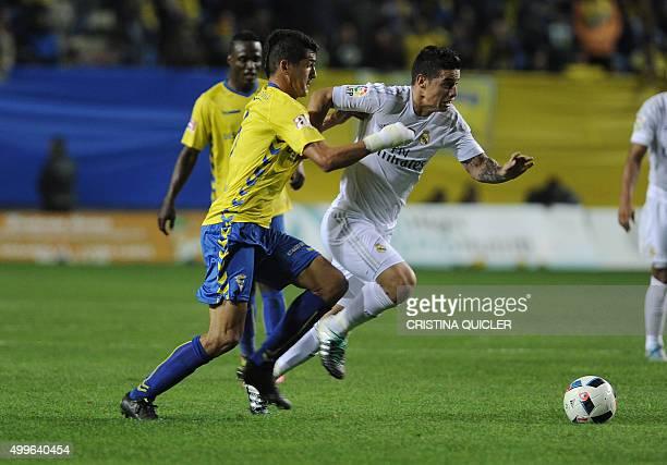 Real Madrid's Colombian midfielder James Rodriguez vies with Cadiz's midfielder Jon Ander during the Spanish Copa del Rey football match Cadiz CF vs...
