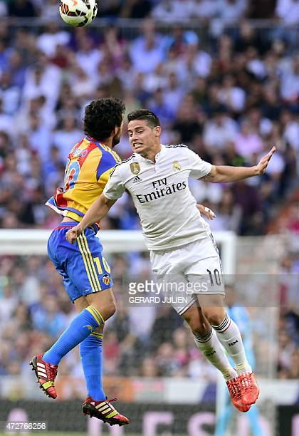 Real Madrid's Colombian midfielder James Rodriguez vies with Valencia's midfielder Dani Parejo during the Spanish league football match Real Madrid...