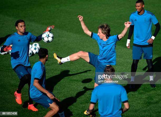 Real Madrid's Costa Rican goalkeeper Keylor Navas and Real Madrid's Croatian midfielder Luka Modric attend a training session at Valdebebas Sport...