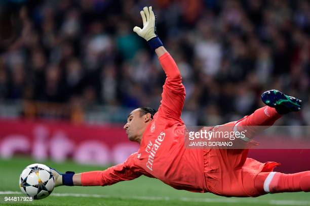 Real Madrid's Costa Rican goalkeeper Keylor Navas dives for the ball during the UEFA Champions League quarterfinal second leg football match between...