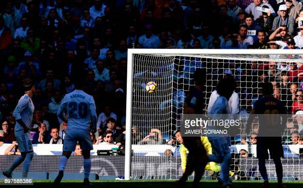 Real Madrid's Costa Rican goalkeeper Keylor Navas eyes the ball during the Spanish League 'Clasico' football match Real Madrid CF vs FC Barcelona at...