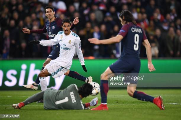 Real Madrid's Costa Rican goalkeeper Keylor Navas grabs the ball as Paris SaintGermain's Argentinian forward Angel Di Maria Real Madrid's French...