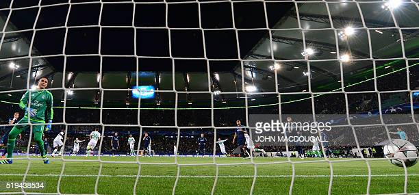 Real Madrid's Costa Rican goalkeeper Keylor Navas misses a penalty kick from Real Madrid's forward Jese Rodriguez during the UEFA Champions League...