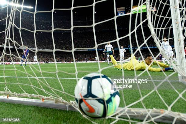 Real Madrid's Costa Rican goalkeeper Keylor Navas reacts as Barcelona score during the Spanish league football match between FC Barcelona and Real...