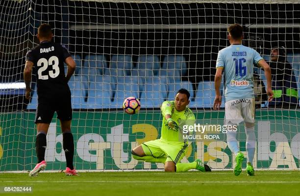 Real Madrid's Costa Rican goalkeeper Keylor Navas stops a ball during the Spanish league football match RC Celta de Vigo vs Real Madrid CF at the...