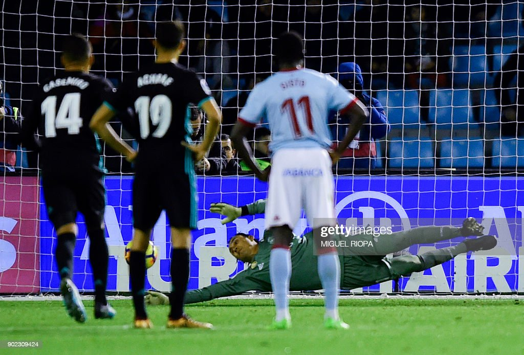 Real Madrid's Costa Rican goalkeeper Keylor Navas stops a penalty shot by Celta Vigo's forward Iago Aspas during the Spanish league football match Celta de Vigo vs Real Madrid at the Balaidos stadium in Vigo on January 7, 2018. /