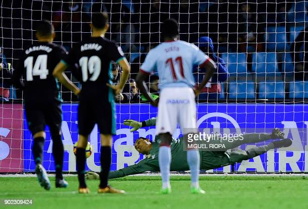 Real Madrid's Costa Rican goalkeeper Keylor Navas stops a penalty shot by Celta Vigo's forward Iago Aspas during the Spanish league football match...