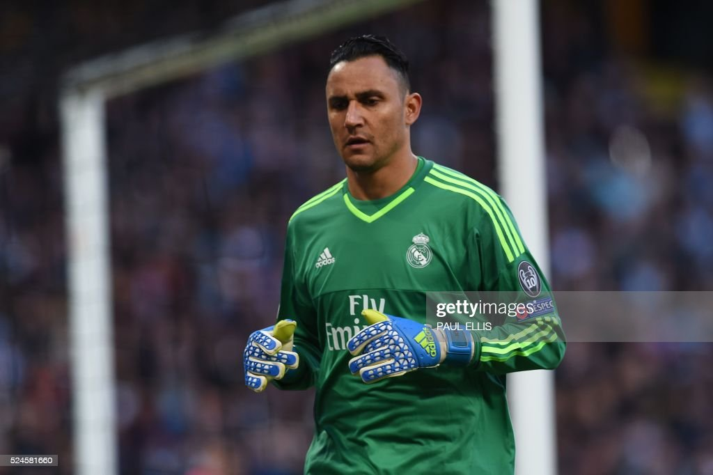 Real Madrid's Costa Rican goalkeeper Keylor Navas warms up before the UEFA Champions League semi-final first leg football match between Manchester City and Real Madrid at the Etihad Stadium in Manchester, northwest England, on April 26, 2016. /