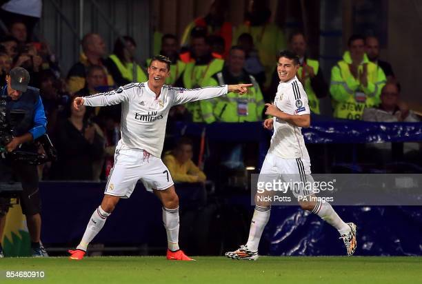 Real Madrid's Cristiano Ronaldo celebrates scoring his side's second goal with James Rodriguez during the UEFA Super Cup Final at the Cardiff City...
