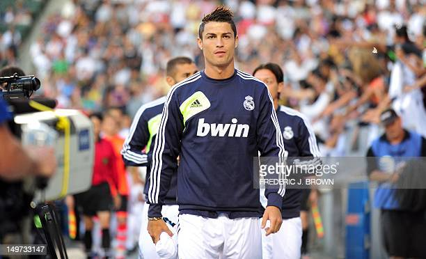 Real Madrid's Cristiano Ronaldo leads the team onto the field against the LA Galaxy in their World Football Challenge friendly football match on...