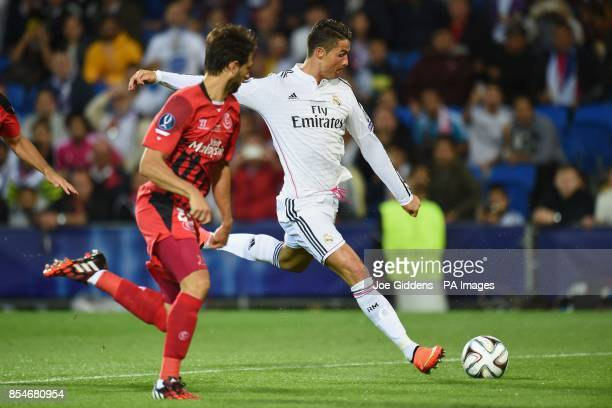 Real Madrid's Cristiano Ronaldo scores his second goal during the UEFA Super Cup Final at the Cardiff City Stadium Cardiff