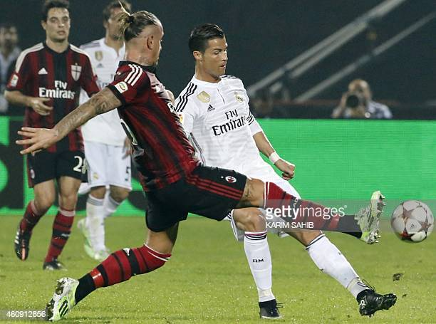 Real Madrid's Cristiano Ronaldo vies for the ball against AC Milan's player Philippe Mexes during their world club friendly football match at the...