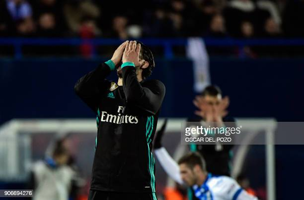 Real Madrid's Croatian midfield forward Mateo Kovacic reacts after missing a goal opportunity during the Spanish 'Copa del Rey' football match...