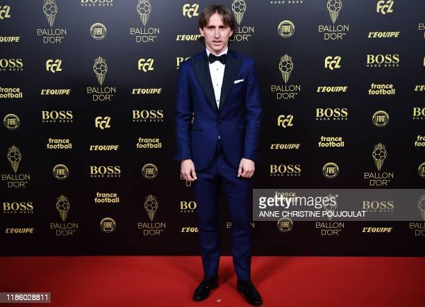 Real Madrid's Croatian midfielder and last year's Ballon d'Or Luka Modric arrives to attend the Ballon d'Or France Football 2019 ceremony at the...