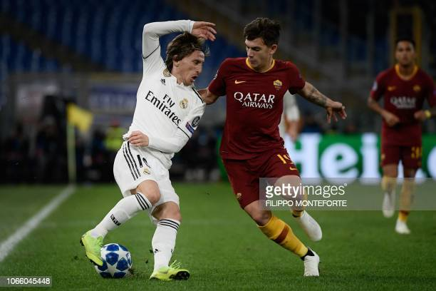 Real Madrid's Croatian midfielder Luka Modric and AS Roma Croatian midfielder Ante Coric go for the ball during the UEFA Champions League group G...