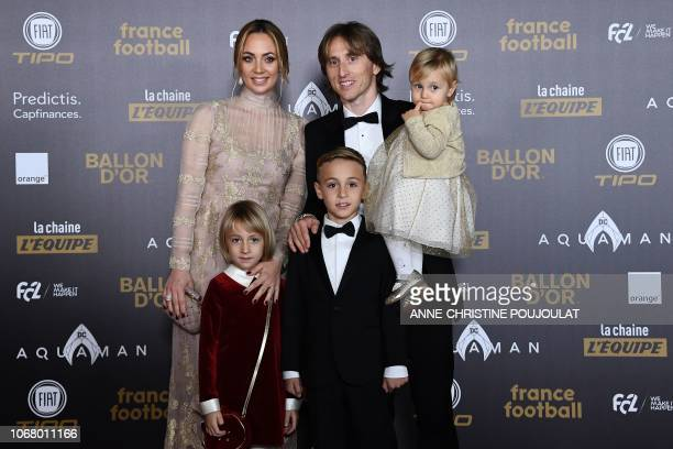 TOPSHOT Real Madrid's Croatian midfielder Luka Modric and his family pose upon arrival at the 2018 Ballon d'Or award ceremony at the Grand Palais in...