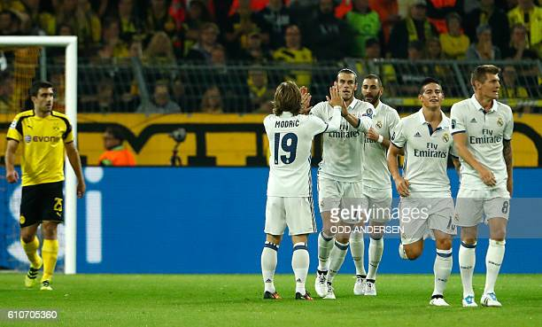 Real Madrid's Croatian midfielder Luka Modric and Real Madrid's Welsh forward Gareth Bale celebrate after Real Madrid's Portuguese forward Cristiano...