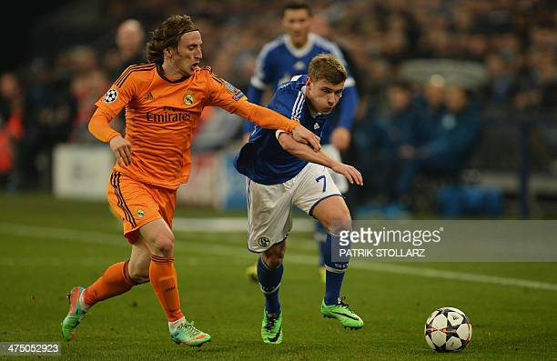 Real Madrid's Croatian midfielder Luka Modric and Schalke's midfielder Max Meyer vie for the ball during the first-leg round of 16 UEFA Champions...