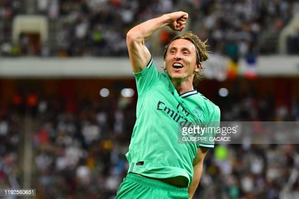 TOPSHOT Real Madrid's Croatian midfielder Luka Modric celebrates his goal during the Spanish Super Cup semi final between Valencia and Real Madrid on...