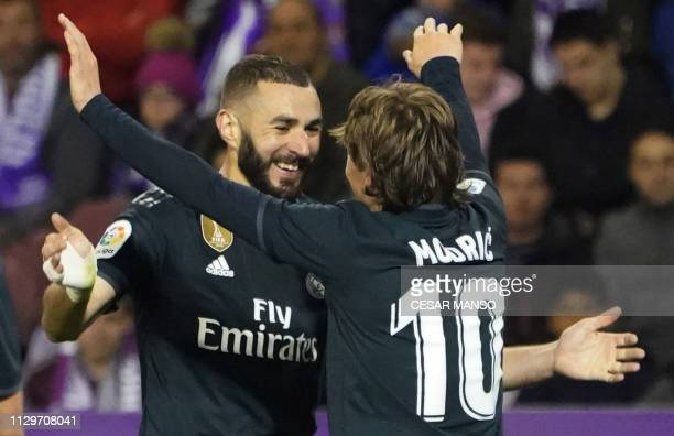 Real Madrid's Croatian midfielder Luka Modric celebrates his goal with Real Madrid's French forward Karim Benzema during the Spanish league football...