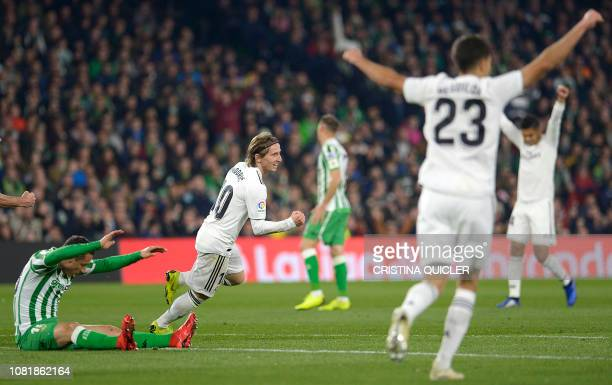 Real Madrid's Croatian midfielder Luka Modric celebrates scoring a goal during the Spanish League football match between Real Betis and Real Madrid...