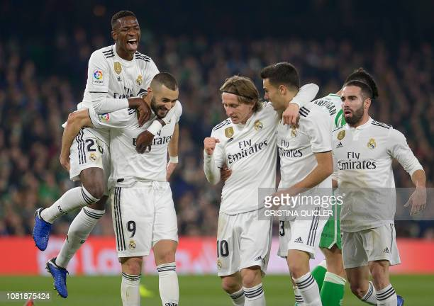 Real Madrid's Croatian midfielder Luka Modric celebrates scoring a goal with teammates during the Spanish League football match between Real Betis...