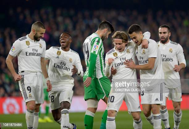 TOPSHOT Real Madrid's Croatian midfielder Luka Modric celebrates scoring a goal with teammates during the Spanish League football match between Real...
