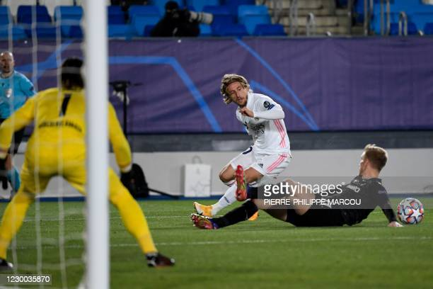 Real Madrid's Croatian midfielder Luka Modric challkenges Moenchengladbach's Swedish defender Oscar Wendt during the UEFA Champions League group B...
