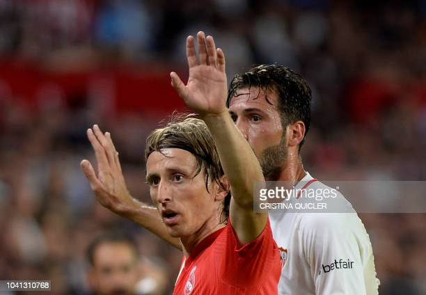 Real Madrid's Croatian midfielder Luka Modric gestures during the Spanish league football match Sevilla FC against Real Madrid CF at the Ramon...