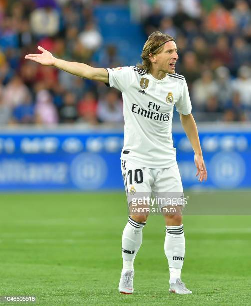 Real Madrid's Croatian midfielder Luka Modric gestures during the Spanish league football match between Deportivo Alaves and Real Madrid CF at the...