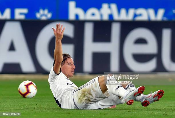 Real Madrid's Croatian midfielder Luka Modric gestures from the ground during the Spanish league football match between Deportivo Alaves and Real...